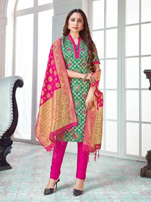 Celebrate This Festive Season In A Proper Traditional Look Wearing This Weaved Straight Suit In Sea Green Colored Top Paired With Rani Pink colored Bottom And Dupatta. This Pretty Suit Is Banarasi Silk Based Beautified With Weave. Its Fabric Gives A Rich Look To Your Personality