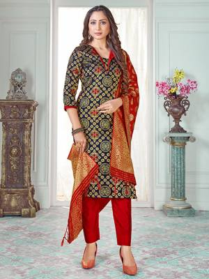 Celebrate This Festive Season In A Proper Traditional Look Wearing This Weaved Straight Suit In Navy Blue Colored Top Paired With Red colored Bottom And Dupatta. This Pretty Suit Is Banarasi Silk Based Beautified With Weave. Its Fabric Gives A Rich Look To Your Personality