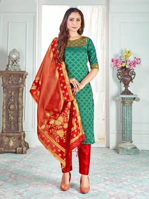 Here Is A Rich And Elegant Looking Silk Based Straight Suit In Sea Green Colored Top Paired With Red Colored Bottom And Dupatta. Its Top And Dupatta Are Fabricated On Banarasi Silk Paired with Art Silk Bottom.