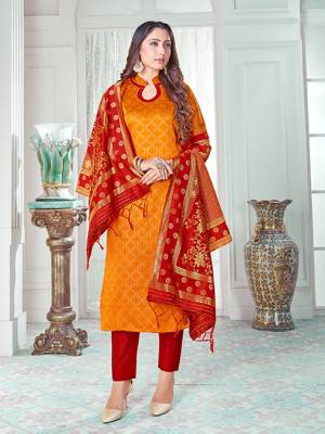 Celebrate This Festive Season In A Proper Traditional Look Wearing This Weaved Straight Suit In Musturd Yellow Colored Top Paired With Red colored Bottom And Dupatta. This Pretty Suit Is Banarasi Silk Based Beautified With Weave. Its Fabric Gives A Rich Look To Your Personality