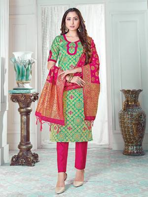 Here Is A Rich And Elegant Looking Silk Based Straight Suit In Sea Green Colored Top Paired With Rani Pink Colored Bottom And Dupatta. Its Top And Dupatta Are Fabricated On Banarasi Silk Paired with Art Silk Bottom.