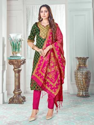 Celebrate This Festive Season In A Proper Traditional Look Wearing This Weaved Straight Suit In Dark Green Colored Top Paired With Rani Pink colored Bottom And Dupatta. This Pretty Suit Is Banarasi Silk Based Beautified With Weave. Its Fabric Gives A Rich Look To Your Personality