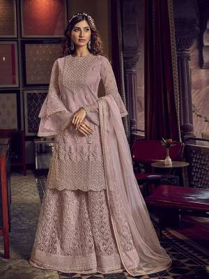 Look Pretty In This Heavy Designer Shararar Suit In Dusty Pink Color. Its Beautiful Top, Bottom and Dupatta Are Fabricated On Net Beautified With Heavy Detailed Embroidery. Its Pretty Color And Embroidery Will Earn You Lots Of compliments From Onlookers.