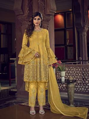 Add This Very Beautiful Heavy Designer Suit To Your Wardrobe In All Over Yellow Color. Its Embroidered Top, Bottom and Dupatta Are Fabricated On Net Which Is Light In Weight and Easy To Carry Throughtout The Gala.