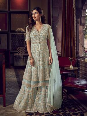 Flaunt Your Rich And Elegant Taste In This Very Pretty Heavy Designer Sharara Suit In Baby Blue Color. Its Top, Bottom and Dupatta Are Fabricated On Net Beautified With Attractive Detailed Embroidery. Buy Now.