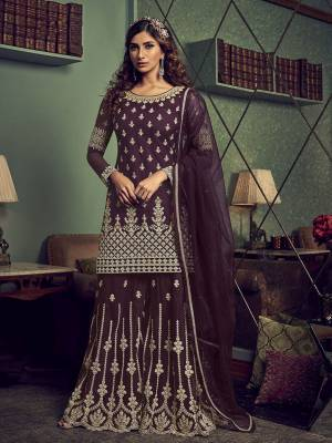 Get Ready For The Upcoming Wedding And Festive Season Wearing This Heavy Designer Sharara Suit In Wine Color. This Sharara Suit In Fabricated On Net Beautified With Heavy Detailed Embroidery Giving An Attractive Look.