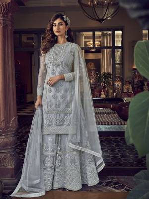 Add This Very Beautiful Heavy Designer Suit To Your Wardrobe In All Over Grey Color. Its Embroidered Top, Bottom and Dupatta Are Fabricated On Net Which Is Light In Weight and Easy To Carry Throughtout The Gala.