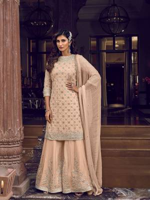 Flaunt Your Rich And Elegant Taste In This Very Pretty Heavy Designer Sharara Suit In Peach Color. Its Top, Bottom and Dupatta Are Fabricated On Georgette Beautified With Attractive Detailed Embroidery. Buy Now.