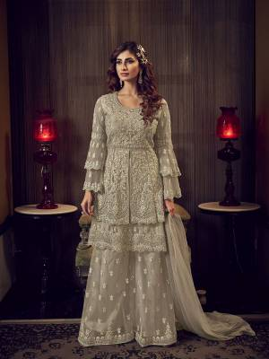 Look Pretty In This Heavy Designer Shararar Suit In Sand Grey Color. Its Beautiful Top, Bottom and Dupatta Are Fabricated On Net Beautified With Heavy Detailed Embroidery. Its Pretty Color And Embroidery Will Earn You Lots Of compliments From Onlookers.