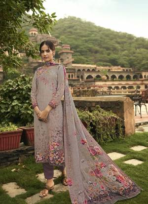 Grab This Pretty Digital Printed Dress Material In Grey And Mauve Color. Its Top And Bottom Are Fabricated On Crepe Paired With Georgette Fabricated Dupatta. Get This Stitched As Per Your Desired Fit And Comfort
