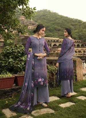Simple And Elegant Looking Printed Dress Material Is Here In Purple?Color. This Suit Is Crepe Based Paired With Georgette Fabricated Dupatta. It Is Beautified With Digital Prints And Embroidery.