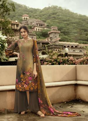 Grab This Pretty Digital Printed Dress Material In Light Brown Color. Its Top And Bottom Are Fabricated On Crepe Paired With Georgette Fabricated Dupatta. Get This Stitched As Per Your Desired Fit And Comfort