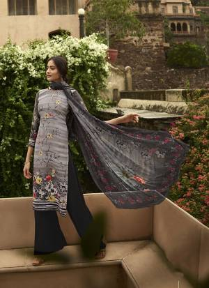 Simple And Elegant Looking Printed Dress Material Is Here In Grey And Black Color. This Suit Is Crepe Based Paired With Georgette Fabricated Dupatta. It Is Beautified With Digital Prints And Embroidery.