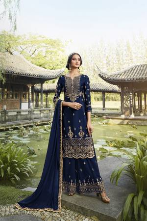 Enhance Your Personality Wearing This Heavy Designer Straight suit In Navy Blue Color. It Pretty Embroidered Top, Bottom and Dupatta Are Fabricated On Georgette Which Is Light In Weight And Easy To Carry Throughout The Gala.