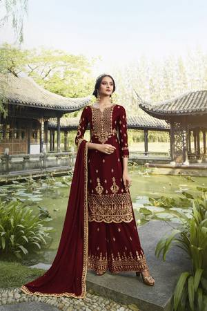 Enhance Your Personality Wearing This Heavy Designer Straight suit In Dark Maroon Color. It Pretty Embroidered Top, Bottom and Dupatta Are Fabricated On Georgette Which Is Light In Weight And Easy To Carry Throughout The Gala.