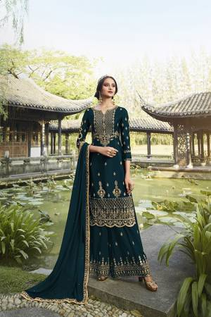 Enhance Your Personality Wearing This Heavy Designer Straight suit In Teal Blue Color. It Pretty Embroidered Top, Bottom and Dupatta Are Fabricated On Georgette Which Is Light In Weight And Easy To Carry Throughout The Gala.