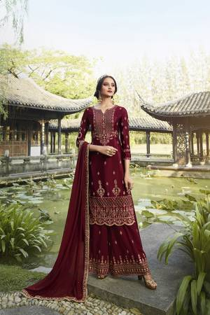 Enhance Your Personality Wearing This Heavy Designer Straight suit In Maroon Color. It Pretty Embroidered Top, Bottom and Dupatta Are Fabricated On Georgette Which Is Light In Weight And Easy To Carry Throughout The Gala.