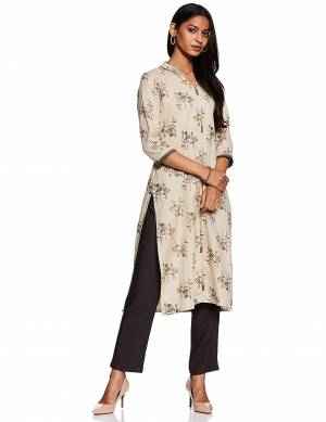 Here Is A Beautiful Readymade Pair Of Kurti With Bottom In Cream And Black Color. This Kurti Is Fabricated On Cotton Beautified With Prints Paired with Rayon Fabricated Plain Bottom.