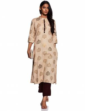 Here Is A Beautiful Readymade Pair Of Kurti With Bottom In Light Beige & Brown Color. This Kurti Is Fabricated On Cotton Beautified With Prints Paired with Rayon Fabricated Plain Bottom.