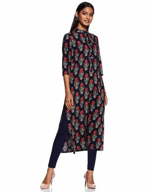 For Your Casual Wear, Grab This Readymade Straight Kurti In Navy Blue Color Fabricated On Rayon Beautified With Floral Prints.