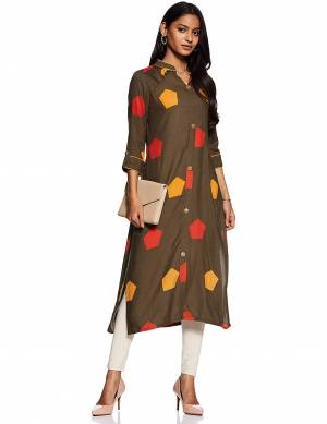 Add This Readymade Kurti To Your Wardrobe In Olive Brown Color Fabricated On Rayon Beautified With Prints. It Is Light In Weight And Easy To Carry All Day Long.