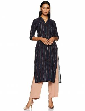 For Your Casual Wear, Grab This Readymade Straight Kurti In Navy Blue Color Fabricated On Cotton Beautified With Lining Prints.