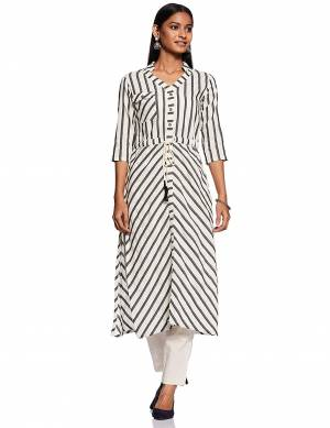Add This Readymade Kurti To Your Wardrobe In White and Grey Color Fabricated On Cotton Beautified With Lining Prints. It Is Light In Weight And Easy To Carry All Day Long.