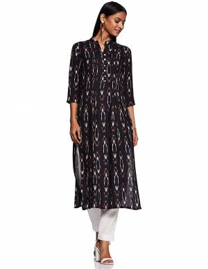 Add This Readymade Kurti To Your Wardrobe In Black Color Fabricated On Rayon Beautified With Ikkat Prints. It Is Light In Weight And Easy To Carry All Day Long.