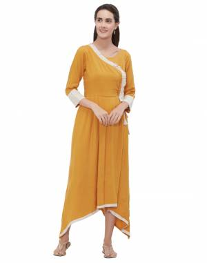 Here Is A Beautiful Looking High Low Patterned Readymade Kurti In Musturd Yellow Color Fabricated On Rayon Flex.
