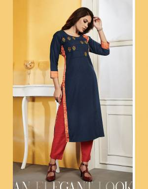 Add This Readymade Kurti To Your Wardrobe In Navy Blue Color Fabricated On Rayon Slub. It Can Be Paired With Same Or Contrasting Colored Bottom. Buy Now.