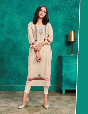 Grab This Pretty Readymade Kurti For Your Casual Or Semi-Casual Wear In Cream Color Fabricated On Cotton. This Pretty Kurti Is Light Weight, Durable And Easy To Carry All Day Long.