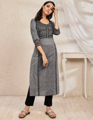 Add This Readymade Kurti To Your Wardrobe In Dark Grey Color Fabricated On South Cotton. It Can Be Paired With Same Or Contrasting Colored Bottom. Buy Now.