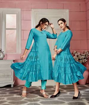 Add This Readymade Kurti To Your Wardrobe In Blue Color Fabricated On Rayon. It Can Be Paired With Same Or Contrasting Colored Bottom. Buy Now.
