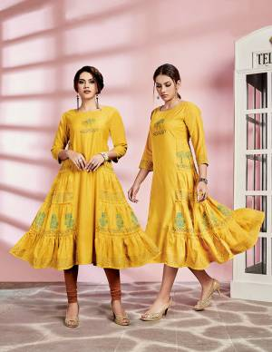 Look Pretty In This Pretty Readymade Kurti In Yellow Color Fabricated On Rayon. This Kurti Is Suitable For Semi-Casual Wear And Available In All Regular Sizes.