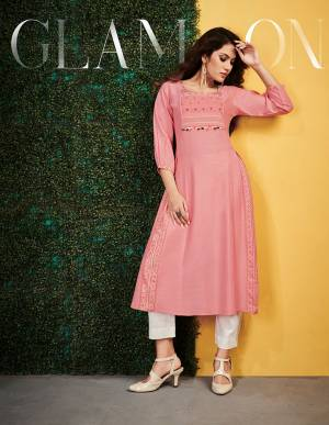 Add This Readymade Kurti To Your Wardrobe In Pink Color Fabricated On Rayon. It Can Be Paired With Same Or Contrasting Colored Bottom. Buy Now.