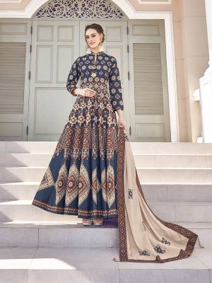 Grab This Very Beautiful Designer Readymade Suit In Navy Blue And Brown Color. Its Lovely Printed Top Is Soft Silk Based Paired With Cotton Leggings And Soft Muslin Fabricated Dupatta. This Readymade Suit Is Beautified With Prints All Over. Also It Is Available In All Regular Sizes. Buy Now.