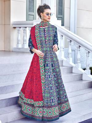 Look Pretty In This Lovely Readymade Designer Floor Length Suit In Blue and Dark Pink Color. Its Top Is Fabricated On Soft Silk Paired With Cotton Leggings And Soft Muslin Fabricated Dupatta. Buy This Pretty Suit Now.