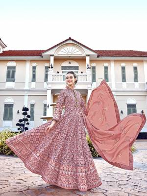 Grab This Very Beautiful Designer Readymade Suit In Dusty Pink Color. Its Lovely Printed Top Is Soft Silk Based Paired With Cotton Leggings And Soft Muslin Fabricated Dupatta. This Readymade Suit Is Beautified With Prints All Over. Also It Is Available In All Regular Sizes. Buy Now.