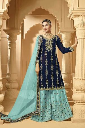 Here Is A Very Beautiful Designer Heavy Suit In Navy Blue Color Paired With Sky Blue Colored bottom And Dupatta. Its Embroidered Top And Bottom Are Georgette Based Paired with Net Fabricated Dupatta.