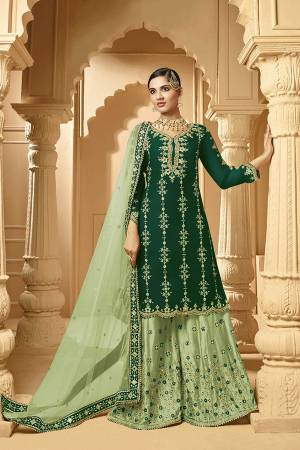 Here Is A Very Beautiful Designer Heavy Suit In Green Color Paired With Light Green Colored bottom And Dupatta. Its Embroidered Top And Bottom Are Georgette Based Paired with Net Fabricated Dupatta.