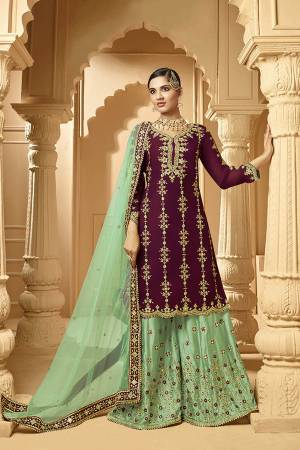 Here Is A Very Beautiful Designer Heavy Suit In Magenta Pink Color Paired With Light Green Colored bottom And Dupatta. Its Embroidered Top And Bottom Are Georgette Based Paired with Net Fabricated Dupatta.