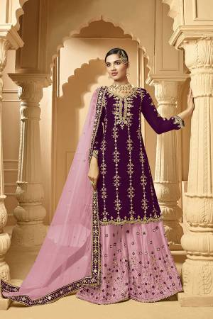 Here Is A Very Beautiful Designer Heavy Suit In Purple Color Paired With Light Purple Colored bottom And Dupatta. Its Embroidered Top And Bottom Are Georgette Based Paired with Net Fabricated Dupatta.