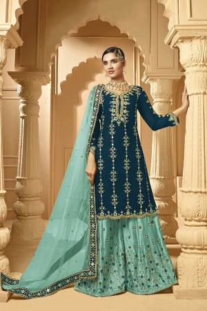 Here Is A Very Beautiful Designer Heavy Suit In Teal Blue Color Paired With Turqoise Blue Colored bottom And Dupatta. Its Embroidered Top And Bottom Are Georgette Based Paired with Net Fabricated Dupatta.