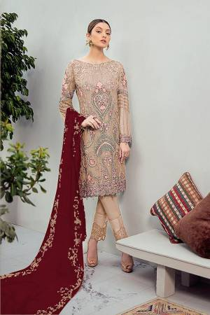 Grab This Beautiful Heavy Designer Pakistani Straight Suit In Beige Color Paired With Maroon Colored Dupatta. Its Heavy Embroidered Top Is Fabricated On Georgette Paired With Santoon Bottom and Georgette Fabricated Embroidered Dupatta.