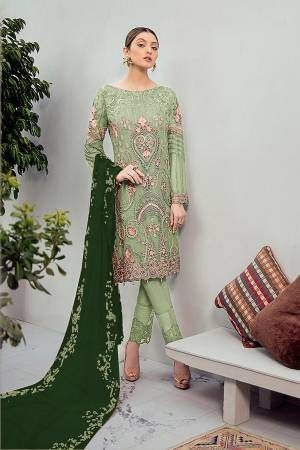 Grab This Beautiful Heavy Designer Pakistani Straight Suit In Light Green Color Paired With Green Colored Dupatta. Its Heavy Embroidered Top Is Fabricated On Georgette Paired With Santoon Bottom and Georgette Fabricated Embroidered Dupatta.
