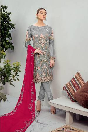 Look Pretty Wearing This Heavy Designer Straight Suit In Grey Color Paired With Dark Pink Colored Dupatta. Its Embroidered Top And Dupatta Are Georgette Based Paired With Santoon Fabricated Bottom. Buy This Pakistani Suit Now.