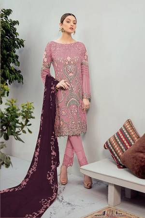 Grab This Beautiful Heavy Designer Pakistani Straight Suit In Dusty Pink Color Paired With Purple Colored Dupatta. Its Heavy Embroidered Top Is Fabricated On Georgette Paired With Santoon Bottom and Georgette Fabricated Embroidered Dupatta.