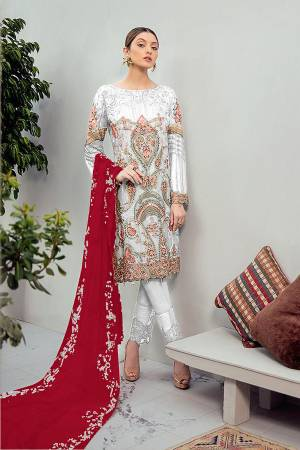 Look Pretty Wearing This Heavy Designer Straight Suit In Light Grey Color Paired With Red Colored Dupatta. Its Embroidered Top And Dupatta Are Georgette Based Paired With Santoon Fabricated Bottom. Buy This Pakistani Suit Now.