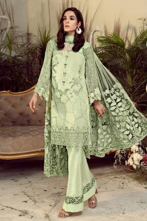 Grab This Pretty Heavy Embroidered Pakistani Designer Suit In Pastel Green Color. Its Embroidered Top Is Georgette Based Paired With Santoon Bottom and Net Fabricated Embroidered Dupatta.