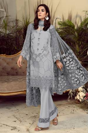 Grab This Pretty Heavy Embroidered Pakistani Designer Suit In Grey Color. Its Embroidered Top Is Georgette Based Paired With Santoon Bottom and Net Fabricated Embroidered Dupatta.